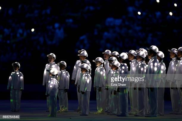 A children's choir sings on stage during the Closing Ceremony on Day 16 of the Rio 2016 Olympic Games at Maracana Stadium on August 21 2016 in Rio de...