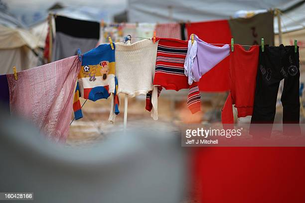 ZA'ATARI JORDAN JANUARY 31 Childrens closthes hang on tents in the Za'atari refugee camp on January 31 2013 in Za'atari Jordan Record numbers of...