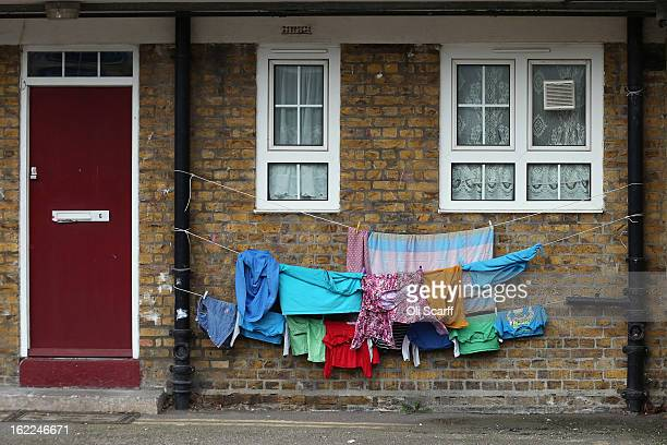 Children's clothing is hung out to dry on a residential development in the London borough of Tower Hamlets on February 21 2013 in London England A...