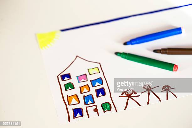 Childrens drawing of a house and family