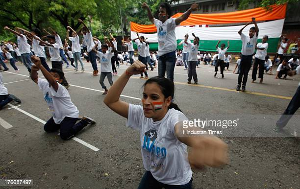 Children's Equality flash mob perform on streets in support of the Uttarakhand Flood Victims at Jantar Mantar on August 17 2013 in New Delhi India In...