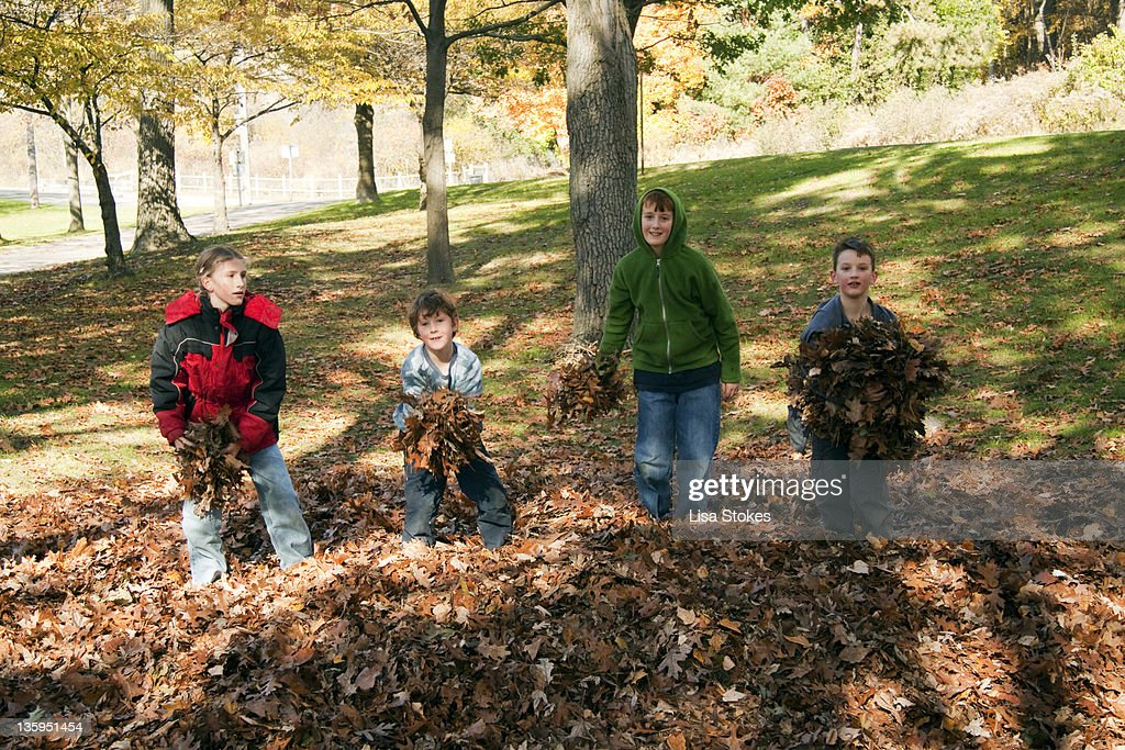 childrens getting ready to throw leaves