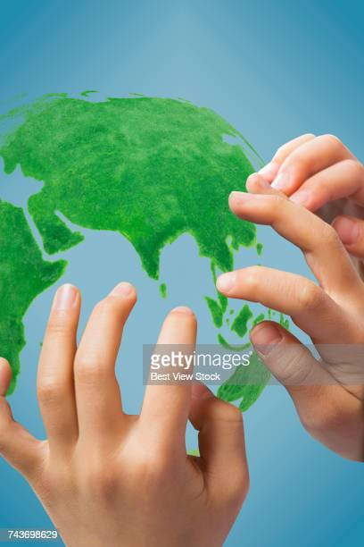 Childrens hands and globes