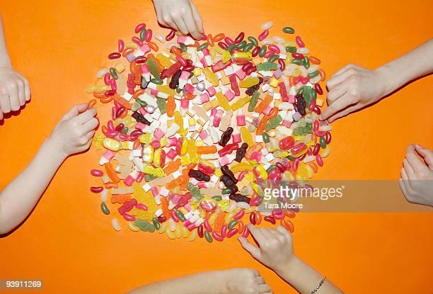 children's hands choosing sweets