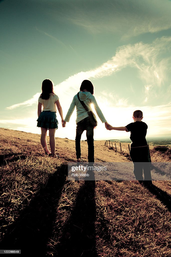 Childrens holding hands : Stock Photo