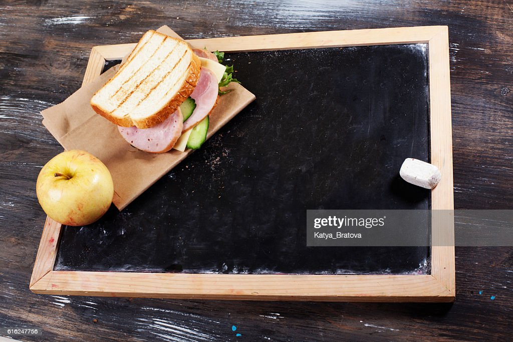Children's lunch to school board, chalk, a space for : Stock Photo