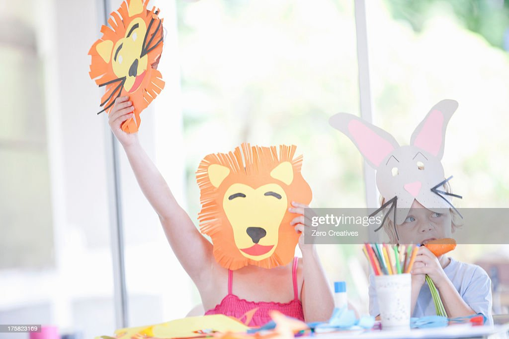 Children's mask making party : Stock Photo