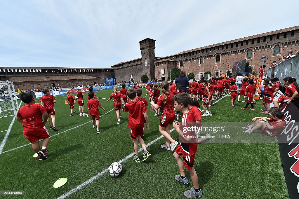 Childrens of the project 'Io Tifo Positivo' play during the Champions Festival prior to the final at Stadio Giuseppe Meazza on May 26, 2016 in Milan, Italy.