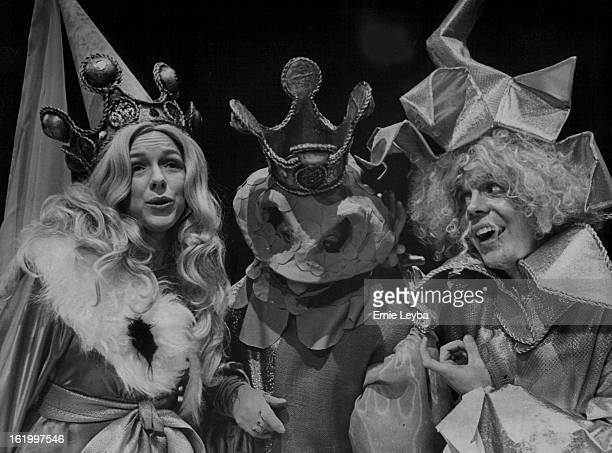 MAR 11 1977 APR 13 1977 Children's Play Bill O'Rourke right who plays 'Zauberfinger tells Princess Blanda at left that the Frog Prince 'was taller...