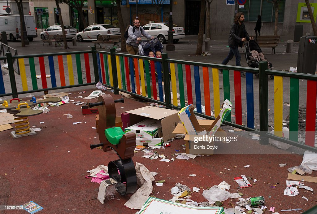 A childrens playground is covered in grabage during the cleaners strike on November 13, 2013 in Madrid, Spain. Street cleaners, garbage collectors and public park gardeners working for Madrid city council started an indefinite strike 9 days ago after the private contracters plan to axe more than 1,000 jobs and introduce a 40% pay cut for the remaining workers.