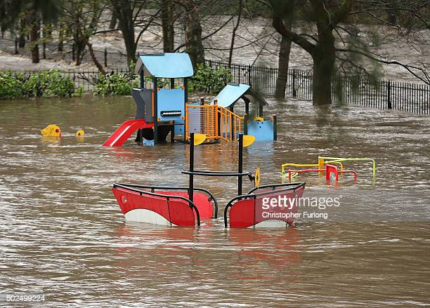 A children's playground is half submerged in water as rivers burst their banks on December 26 2015 in Hebden Bridge England There are more than 200...