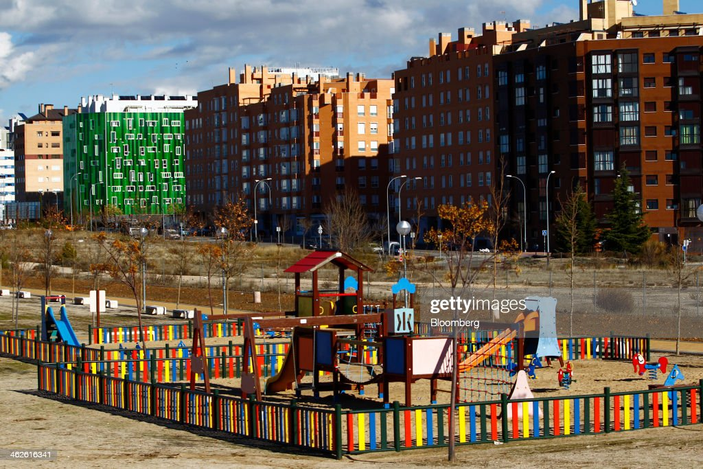A children's playground stands in parkland near residential apartment blocks in Madrid, Spain, on Monday, Jan. 13, 2014. Spain's rental market is growing as government-spending cuts, a 26 percent jobless rate and subdued mortgage lending make home buying more difficult. Photographer: Angel Navarrete/Bloomberg via Getty Images
