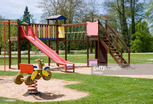 Children's playground with climbing frame and slide