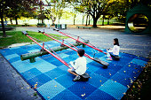 Childrens playing on seesaw
