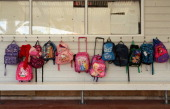 Childrens schoolbags are pictured at Westminster Christian School on May 15 2012 in Auckland New Zealand Minister of Finance Bill English will...