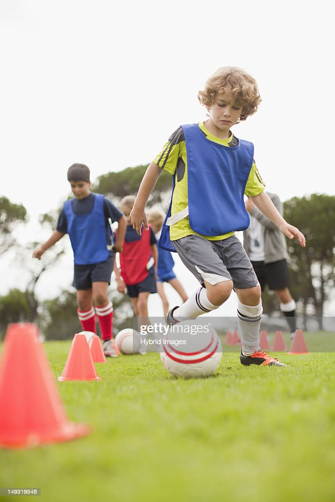 Childrens soccer team training on pitch