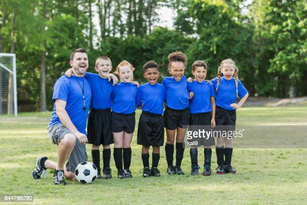 Children's soccer team with coach