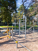 Children`s playground with children's sports complex in municipal park