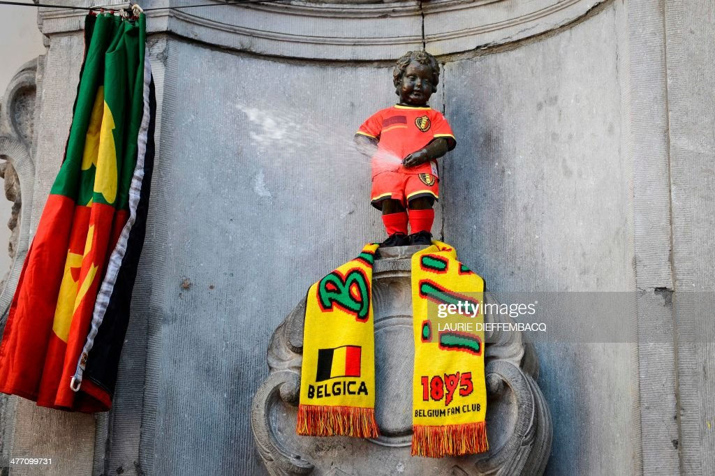 A children's version of the new Belgian national Red Devils football team attire and a Red Devils fan club '1895' are placed on the well known Manneken Pis statue in the center of Brussels, on March 7, 2014. AFP PHOTO / BELGA / LAURIE DIEFFEMBACQ