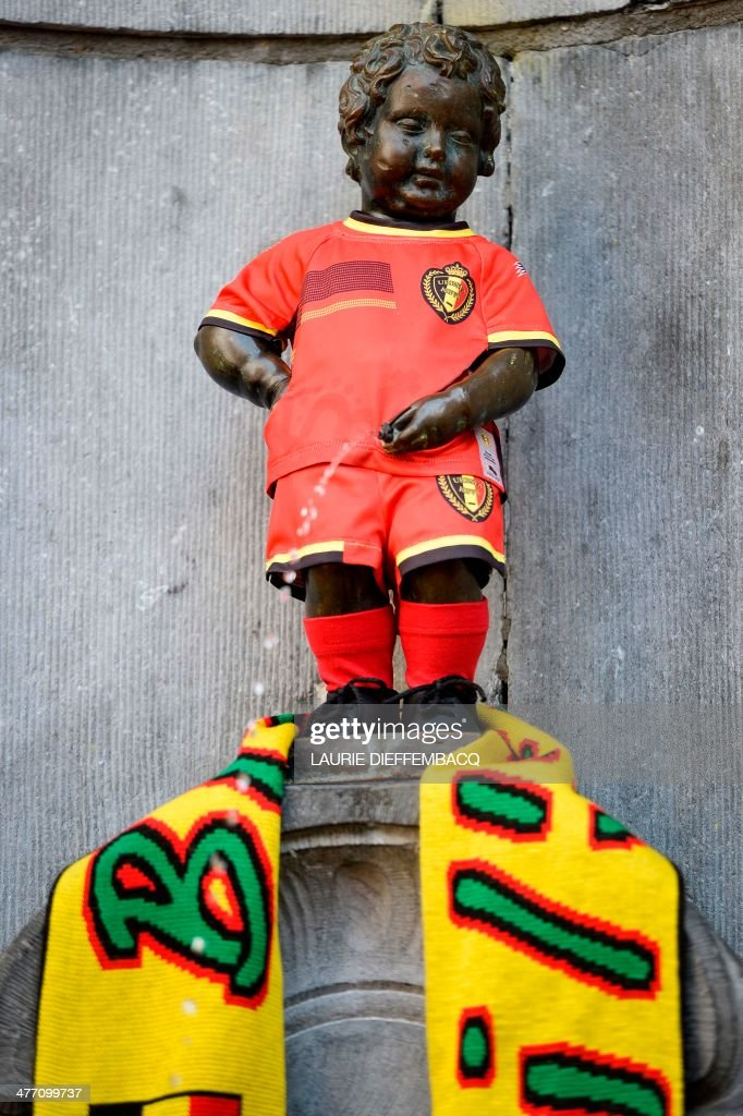 A children's version of the new Belgian national Red Devils football team attire and a Red Devils fan club '1895' are placed on the well known Manneken Pis statue in the center of Brussels, on March 7, 2014.