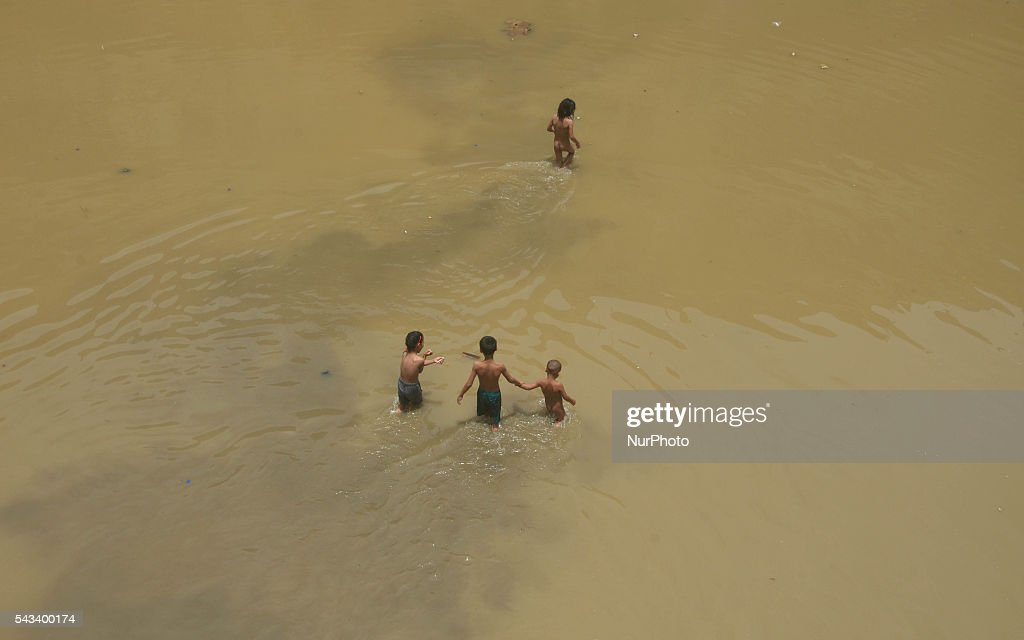 Childrens wade through flood water after a heavy monsoon rain in Dimapur, India north eastern state of Nagaland on Tuesday, June 28, 2016. Thousands of people were render homeless after heavy monsoon rain in the state.