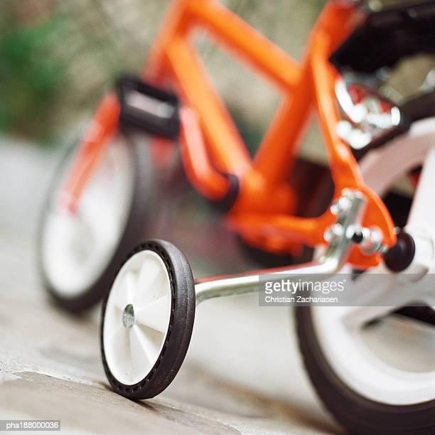 Child's bike with training wheels, close up.