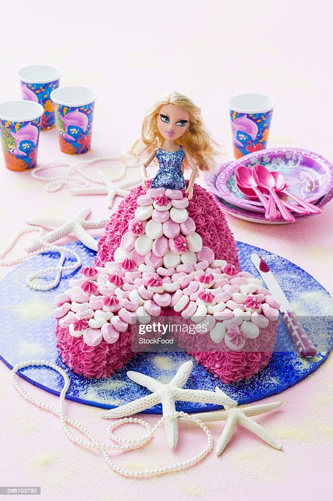 A child's birthday cake with a mermaid doll