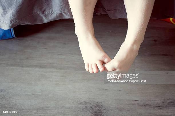 Child's dangling bare feet