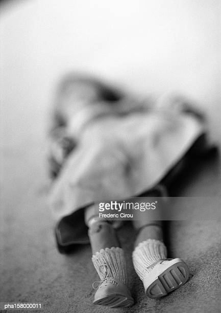 Child's doll, blurred, b&w.