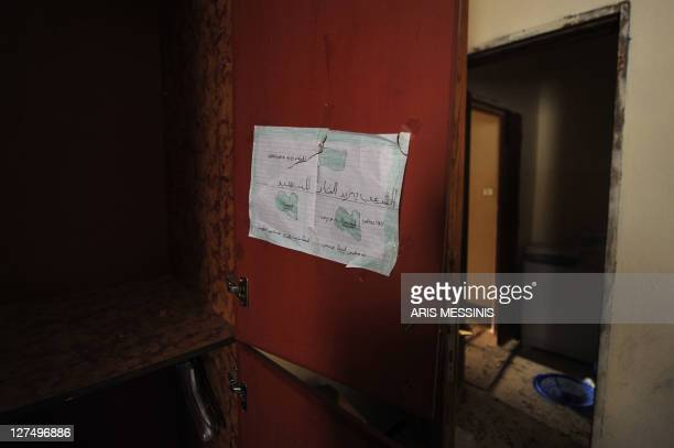A child's drawing in support of Libya's ousted regime is seen at an abandoned house in Tawarga on September 25 2011 The people of Tawarga who are...