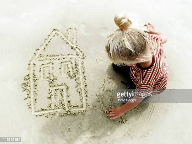 Childs drawing of house in the sand