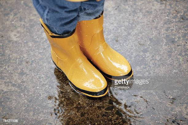 Child's feet in galoshes
