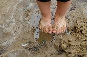 Child's feet in mud