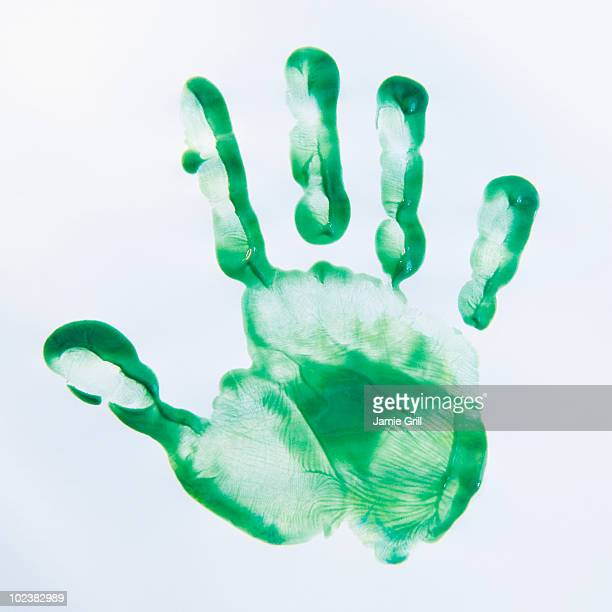 Child's green hand print, close-up
