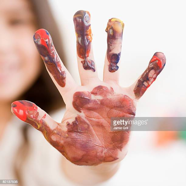 Child?s hand covered in paint