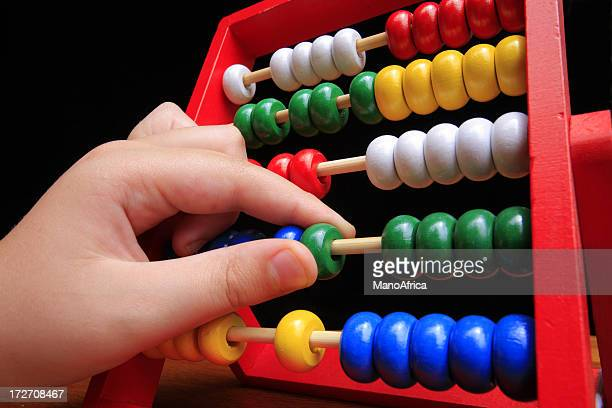 Childs hand on abacus