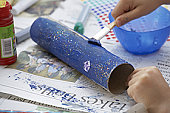 Child's hands painting craft