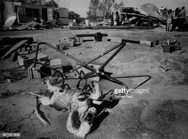 A child's hobby horse lies on its side in the debrisstrewn trailer court that was hit by a t s he tornado in Wray Colo Sunday night The twister...