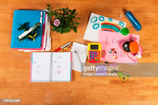 Child's notebooks, pens and toys : Stock Photo