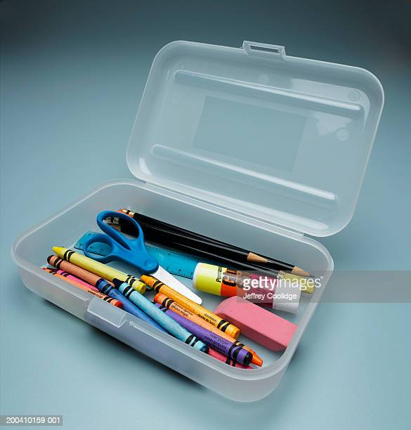 Child's pencil box with crayons and scissors