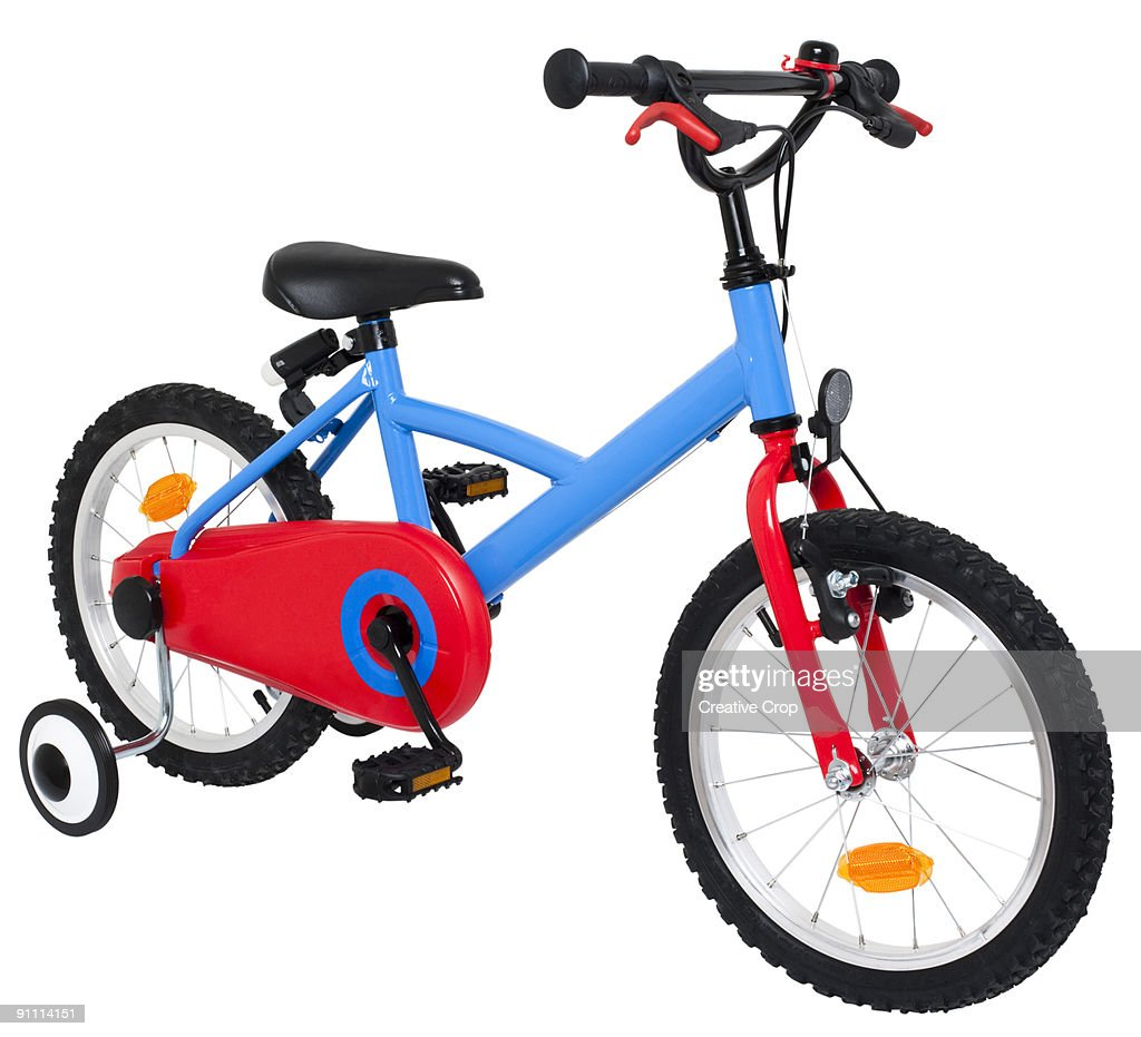 Child's push bike, with stabilisers : Stock Photo