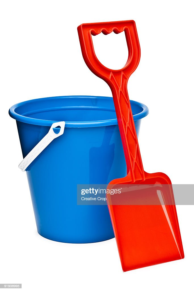 Child's red spade and blue sand bucket