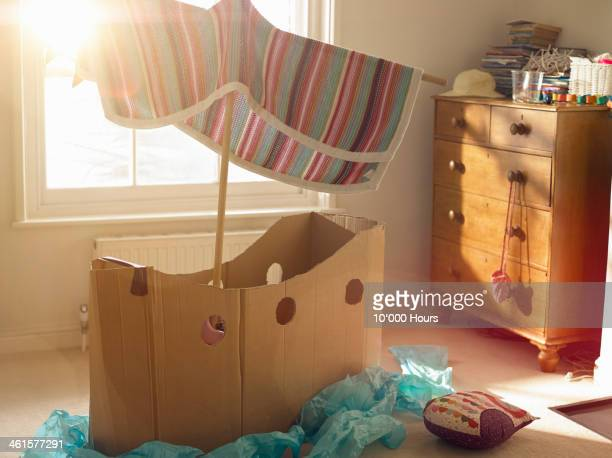 Childs room with home made cardboard boat