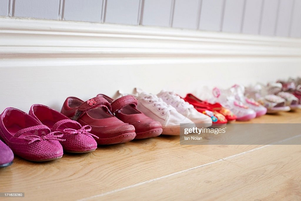 Child's shoes in a row