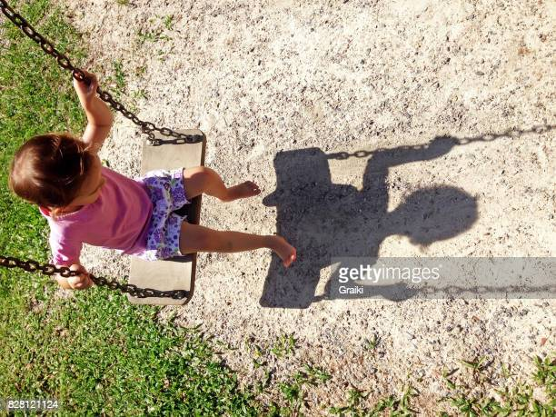 Child's swing and the shadow