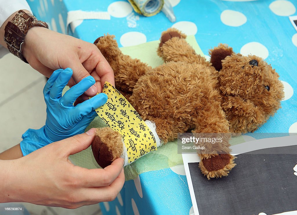 A child's teddy bear receives a plaster cast at the Teddy Bear Clinic at Charite Hospital on May 8, 2013 in Berlin, Germany. Charite Hospital hosts the annual Teddy Bear Clinic days and invites children from Berlin day care centers to bring their injured teddy bears for fictitious examinations, x-rays, surgery and healing as a way for small children to become acquainted with a medical environment.