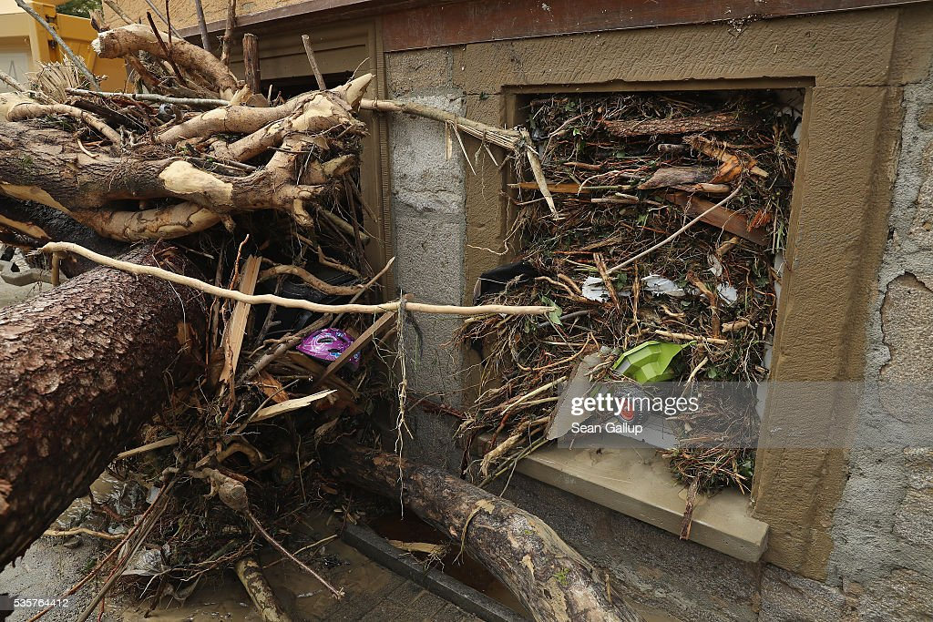A child's toy and bits of smashed trees lie wedged into a window in the village center following a furious flash flood the night before on May 30, 2016 in Braunsbach, Germany. The flood tore through Braunsbach, crushing cars, ripping corners of houses and flooding homes during a storm that hit southwestern Germany. Miraculously no one in Braunsbach was killed, though three people died as a result of the storm in other parts of the country.