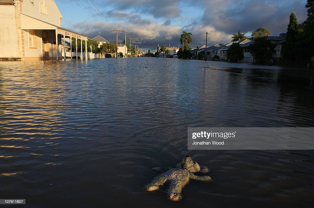 A childs toy floats in flood waters covering a suburban street at sunrise on January 7, 2011 in Rockhampton, Australia. Floodwaters peaked at 9.2 metres two days ago in the central Queensland city just falling short of the predicted peak of 9.4 metres. Water levels are expected to remain high for at least a week, preventing residents from returning to their homes. The Queensland flood crisis has resulted in ten deaths and affected more than 200,000 people across an area as large as France and Germany combined. The flood bill is predicted to be upwards of AUD5 billion.