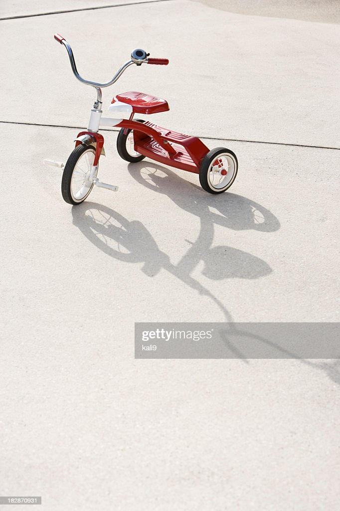 Child's tricycle on driveway