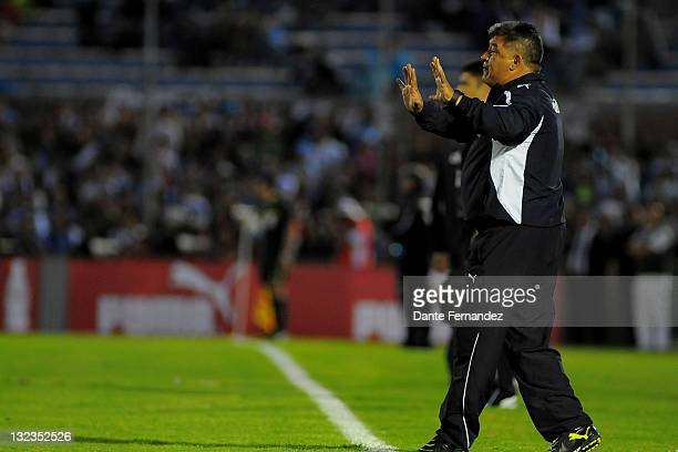 Chile coach Claudio Borghi watches his players during the match between Uruguay and Chile in the third round of the South American World Cup Brazil...